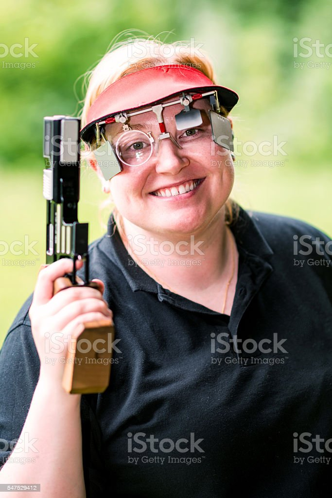 Smiling sport shooting woman stock photo
