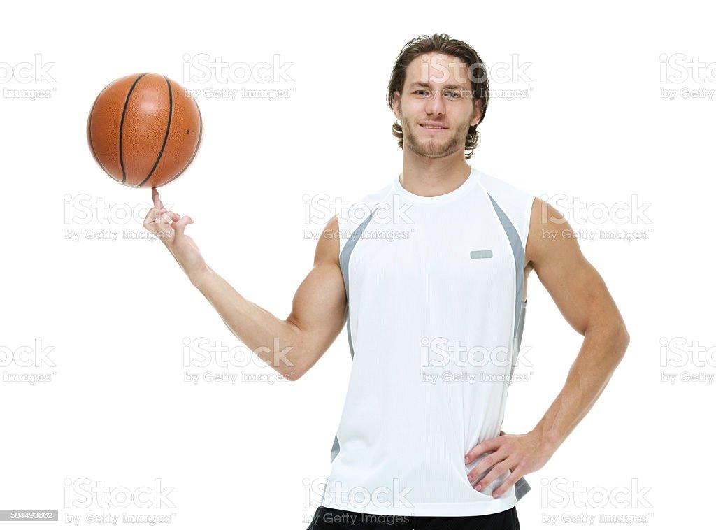 Smiling sports man holding basketball stock photo