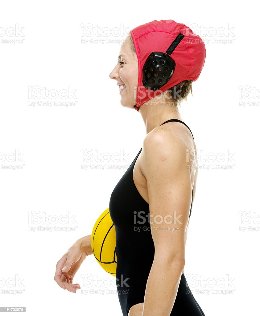Smiling sports woman holding waterpolo ball stock photo