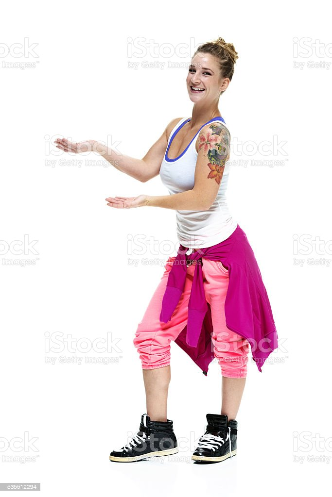 Smiling sports woman presenting stock photo