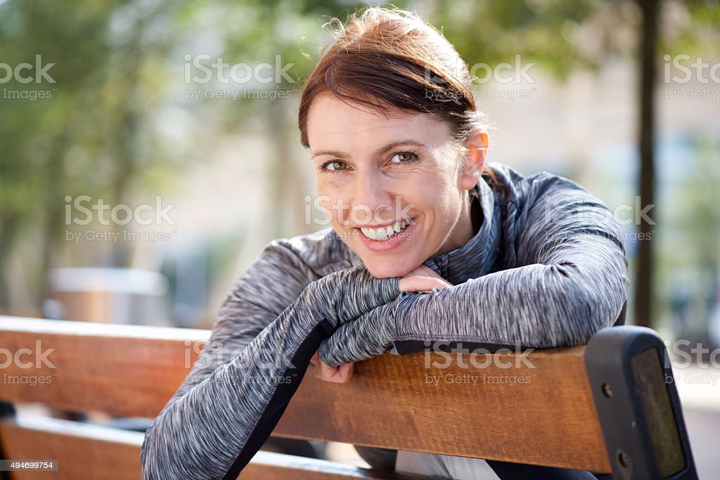 Smiling sports woman relaxing stock photo