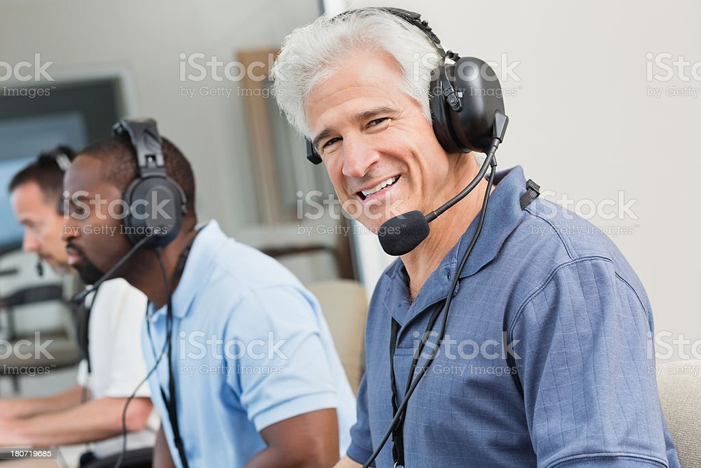 Smiling sportscaster in the sporting event press box stock photo