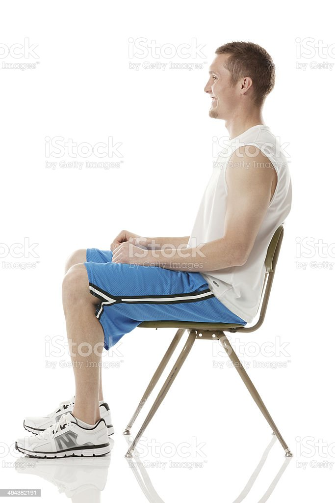 Smiling sportsman sitting on a chair royalty-free stock photo
