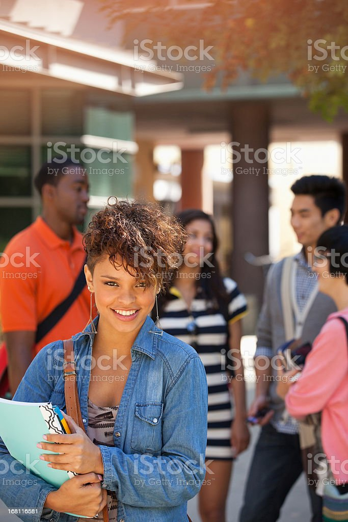 Smiling student carrying folder royalty-free stock photo