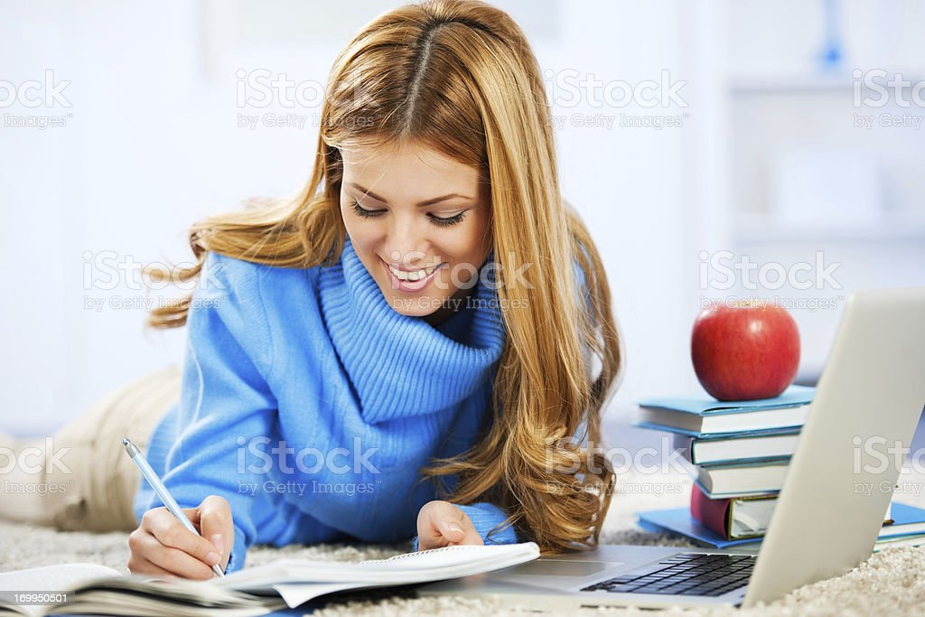 Smiling student girl learning at home. royalty-free stock photo