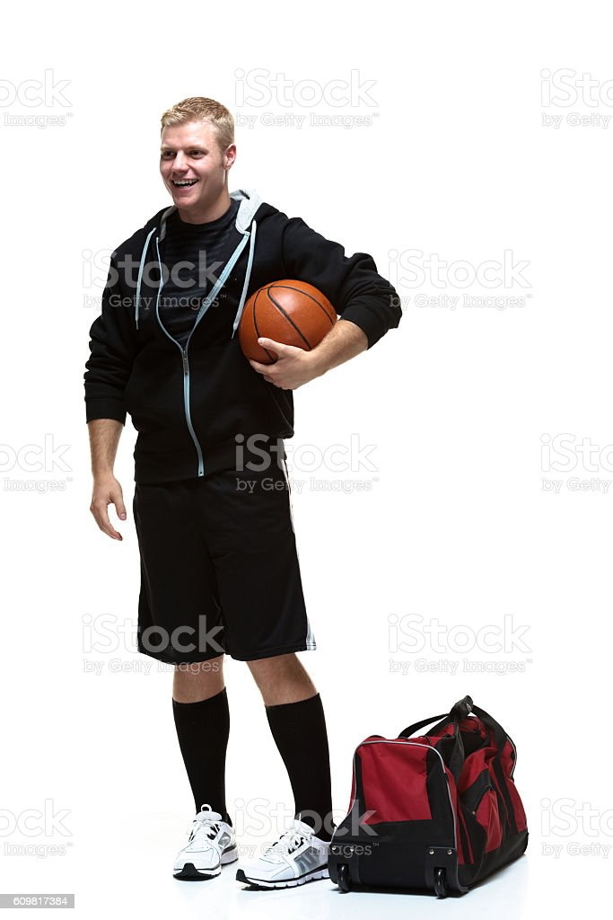 Smiling student holding basketball stock photo