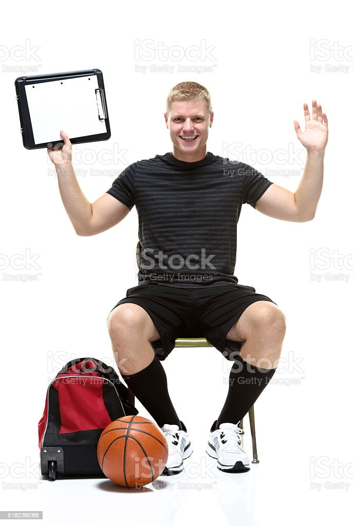 Smiling student holding clipboard stock photo