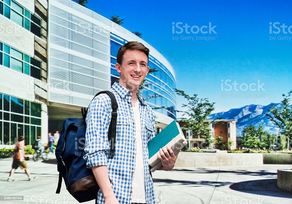 Smiling student in campus stock photo