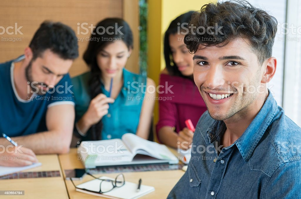 Smiling student looking at camera stock photo