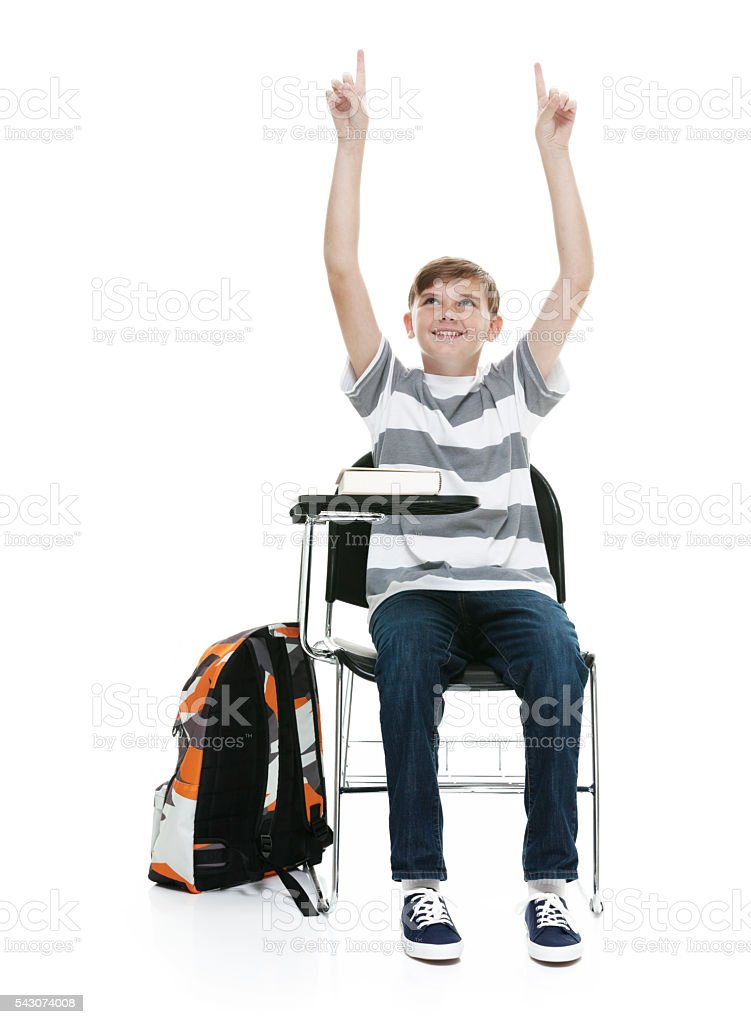 Smiling student sitting and pointing up stock photo