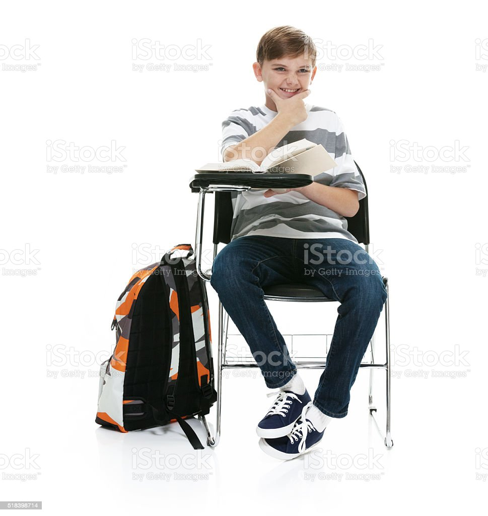 Smiling student sitting on chair stock photo