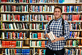 Smiling student standing in library
