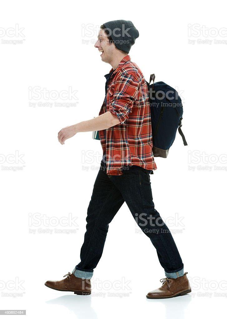 Smiling student walking stock photo