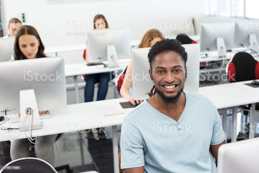 Smiling students in computer class stock photo