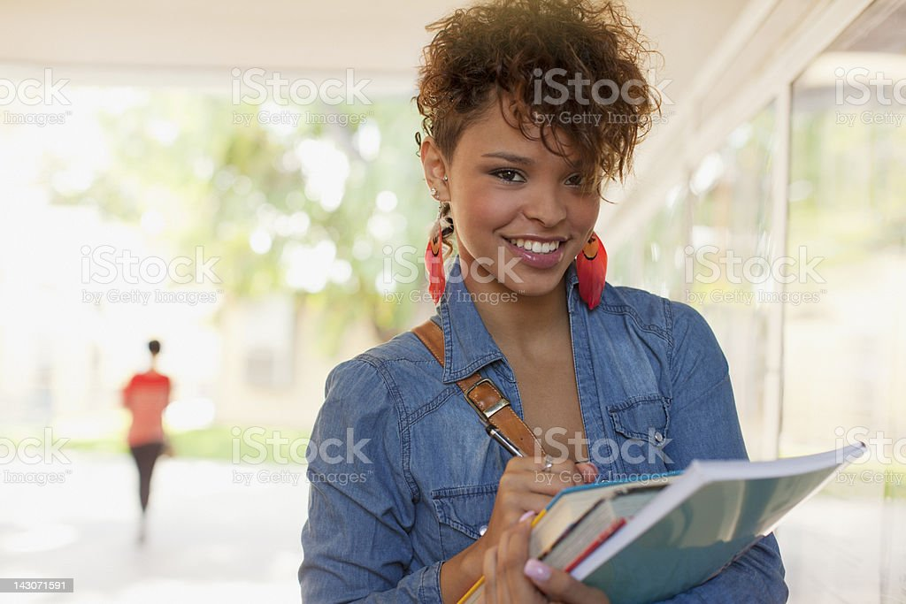 Smiling students standing in hallway royalty-free stock photo