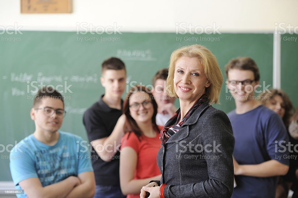 Smiling students with teacher stock photo