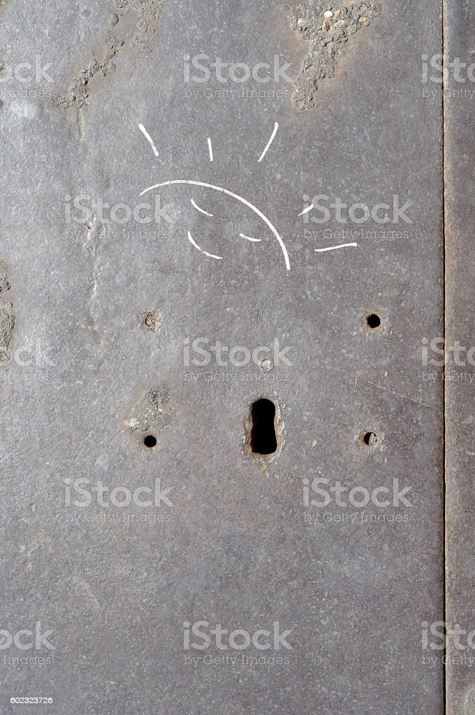 Smiling stylized sun, drawn on a Street of Rome (Italy) stock photo