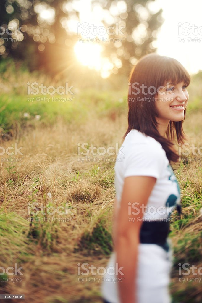 Smiling Sunset Tilt Shifted Woman royalty-free stock photo