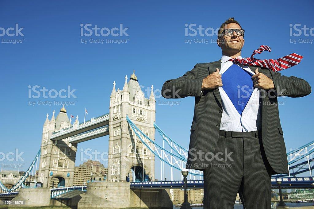 Smiling Superhero Businessman Standing Above London Skyline royalty-free stock photo