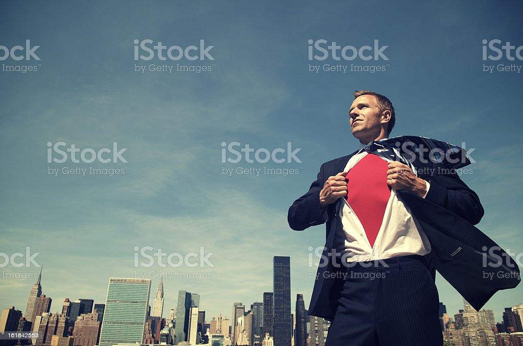 Smiling Superhero Businessman Standing Outdoors City Skyline stock photo