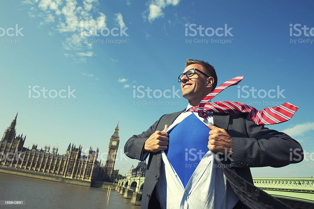 Smiling Superhero Member of Parliament Businessman Stands At London Skyline stock photo
