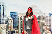 Smiling superhero outdoor and pointing at camera