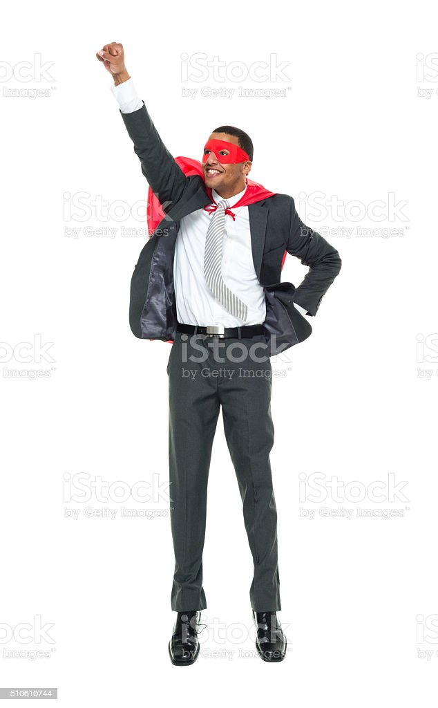 Smiling superhero trying to fly stock photo