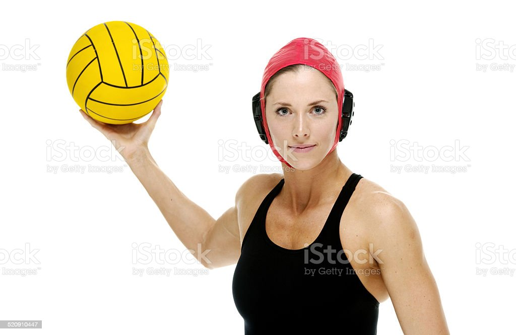 Smiling swimmer throwing waterpolo ball stock photo