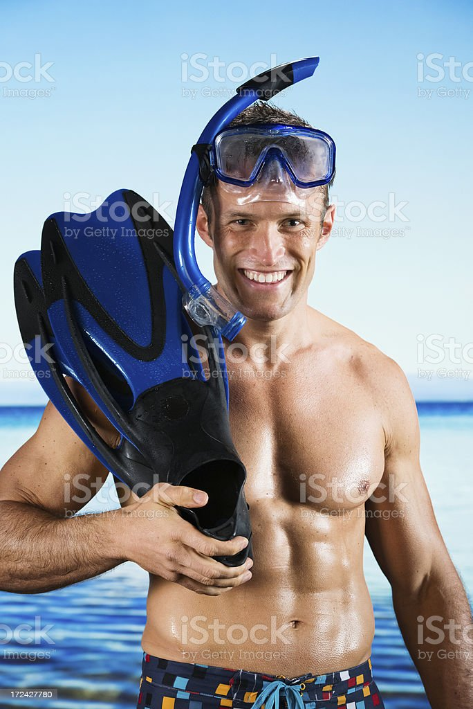Smiling swimmer with snorkel and flippers royalty-free stock photo