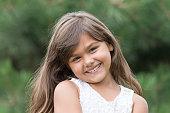 Smiling tanned brunette little girl