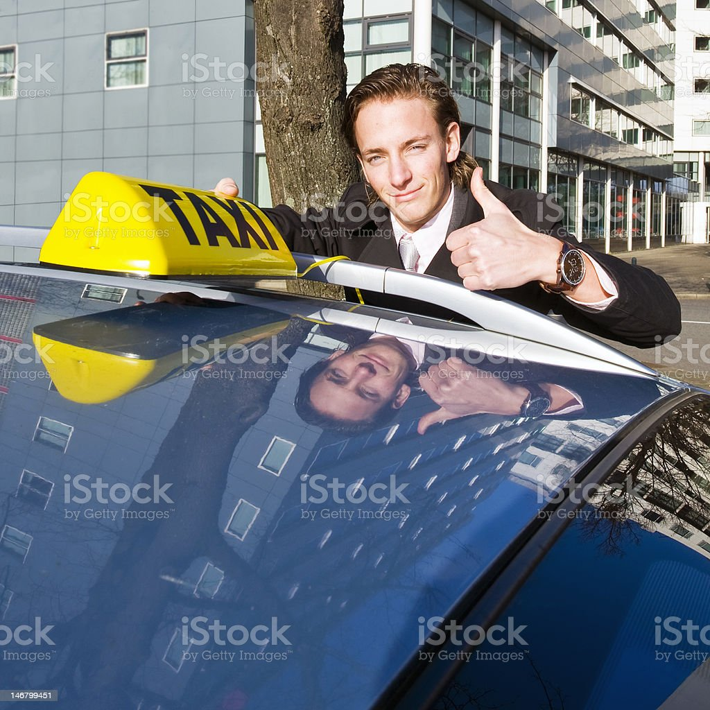 Smiling taxi driver stock photo