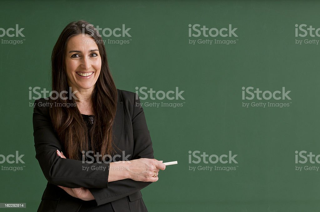 smiling teacher at blackboard royalty-free stock photo