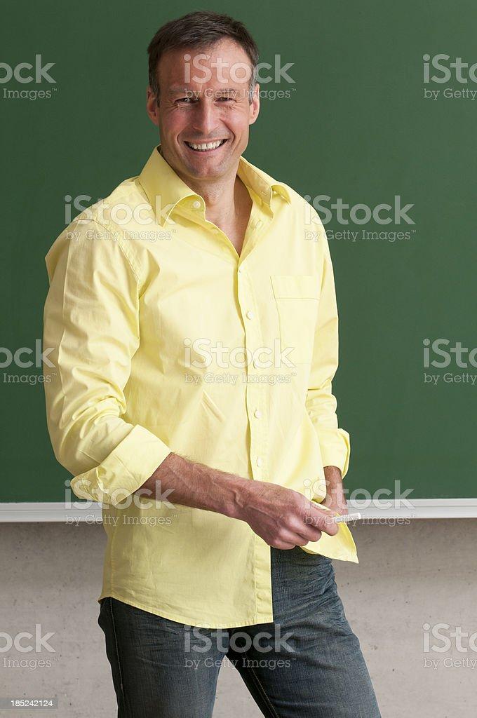 smiling teacher at blackboard royalty-free stock photo