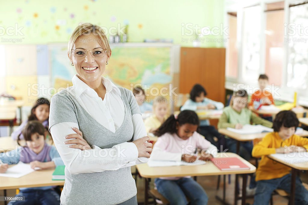 Smiling teacher at the school class stock photo
