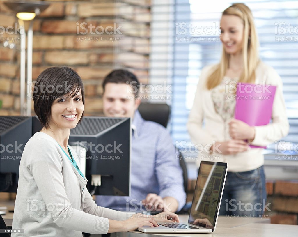 Smiling Team Working  In Office royalty-free stock photo