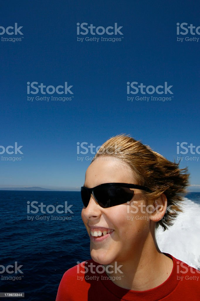 Smiling Teen Boy on a High Speed Boat royalty-free stock photo