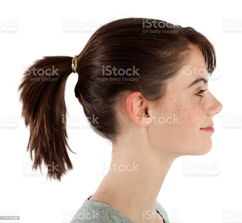 Smiling Teen In Profile With Brunette Ponytail On White royalty-free stock photo