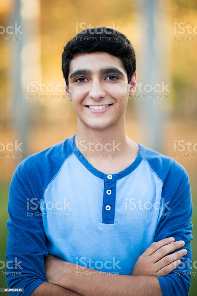 Smiling teenage boy stock photo