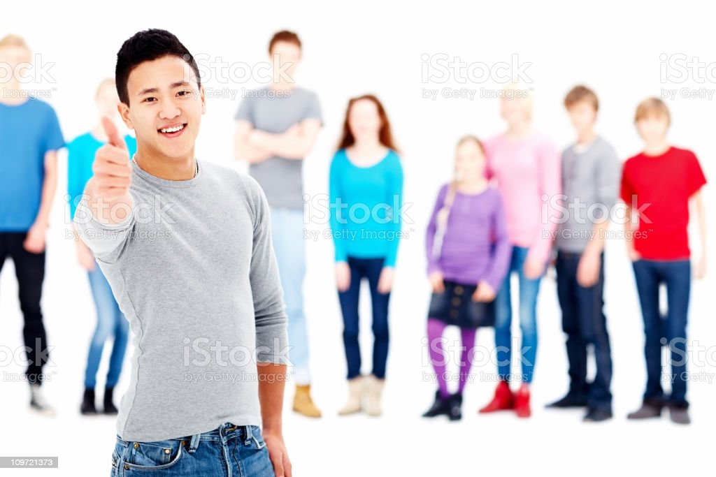 Smiling teenage boy with friends in the background royalty-free stock photo