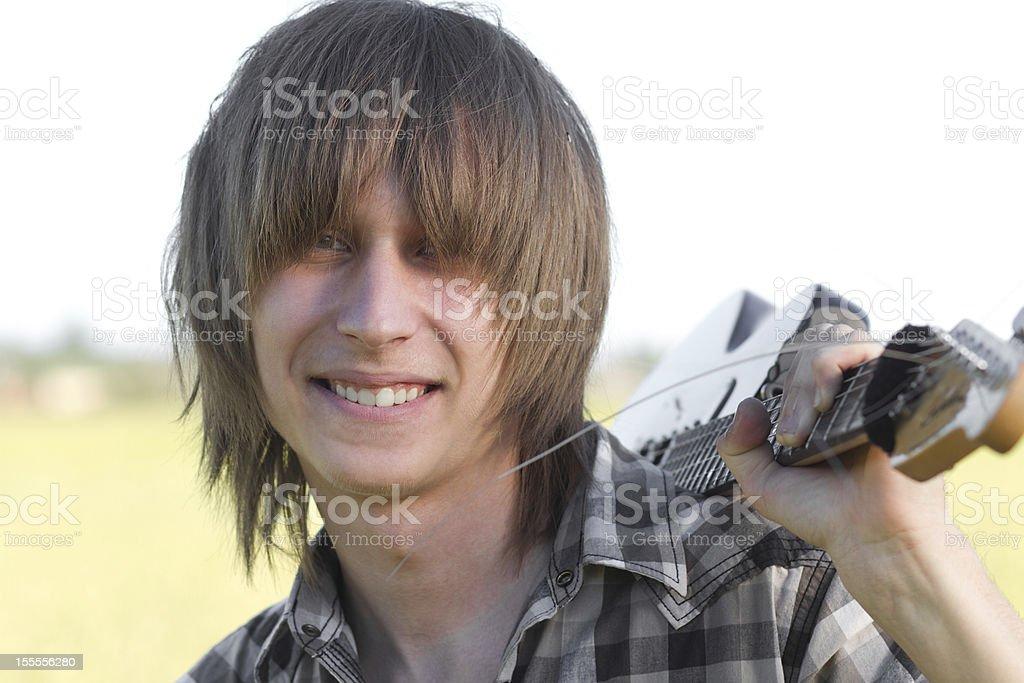 Smiling teenage emo guitarist royalty-free stock photo