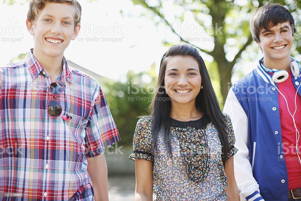 Smiling teenage friends outdoors royalty-free stock photo