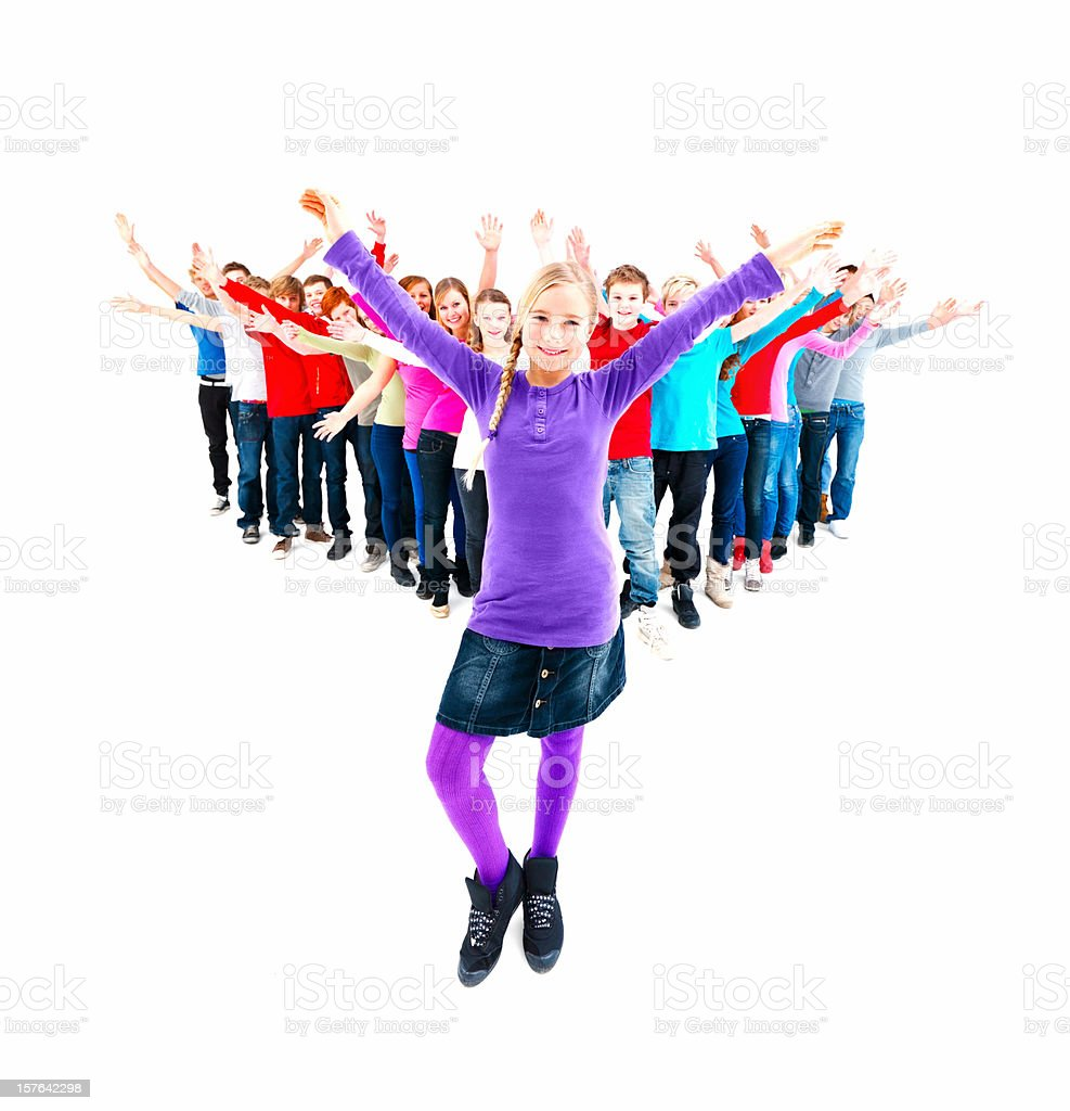 Smiling teenage girl dancing with friends in the background royalty-free stock photo