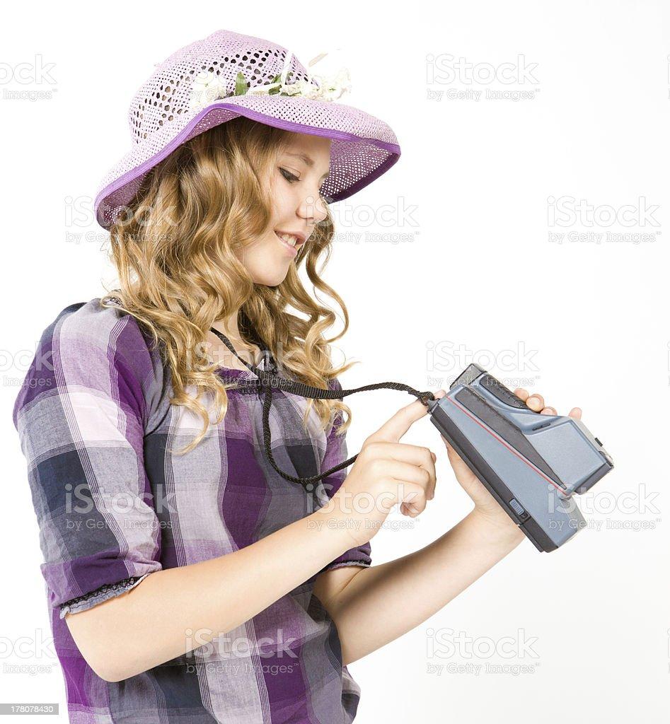 Smiling teenage girl holding a polaroid camera royalty-free stock photo