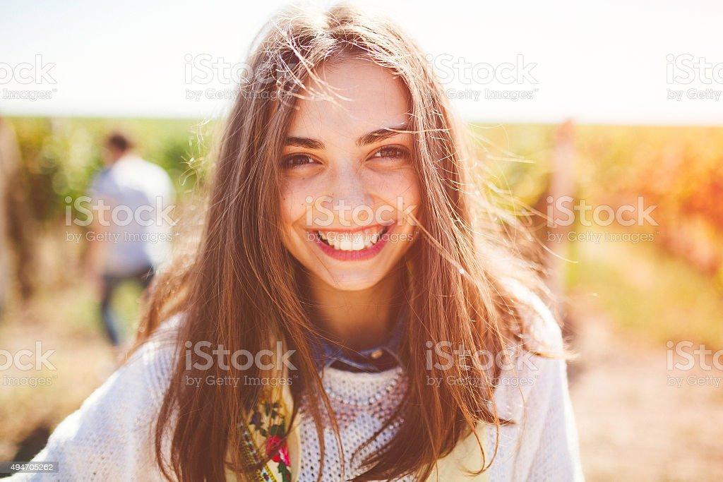 Smiling teenage girl outdoors stock photo