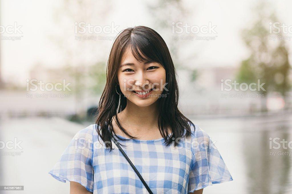 Smiling teenage girl stock photo