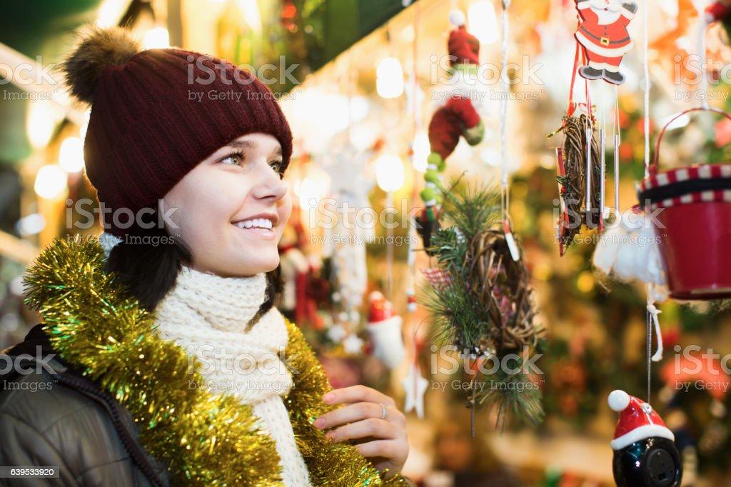 Smiling teenage girl posing at Xmas market stock photo