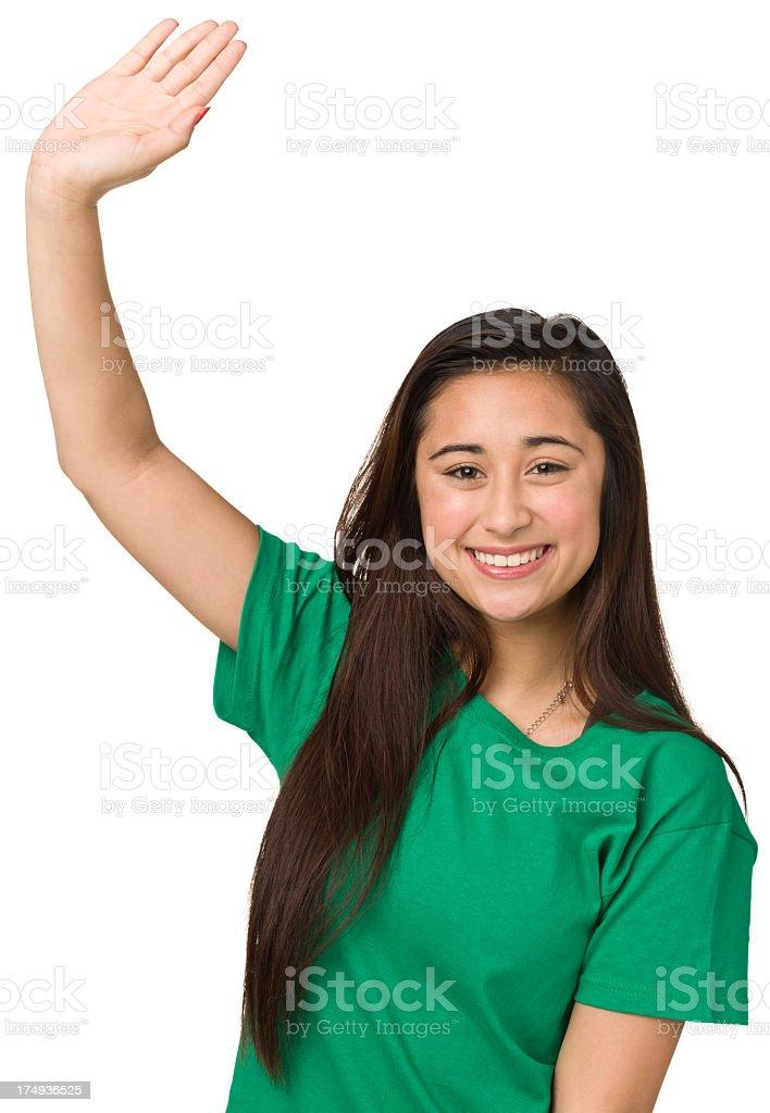 Smiling Teenage Girl Raising Hand stock photo