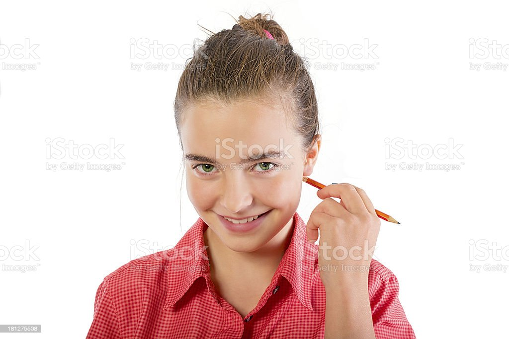 smiling teenage girl scratch with a pencil behind the ear royalty-free stock photo