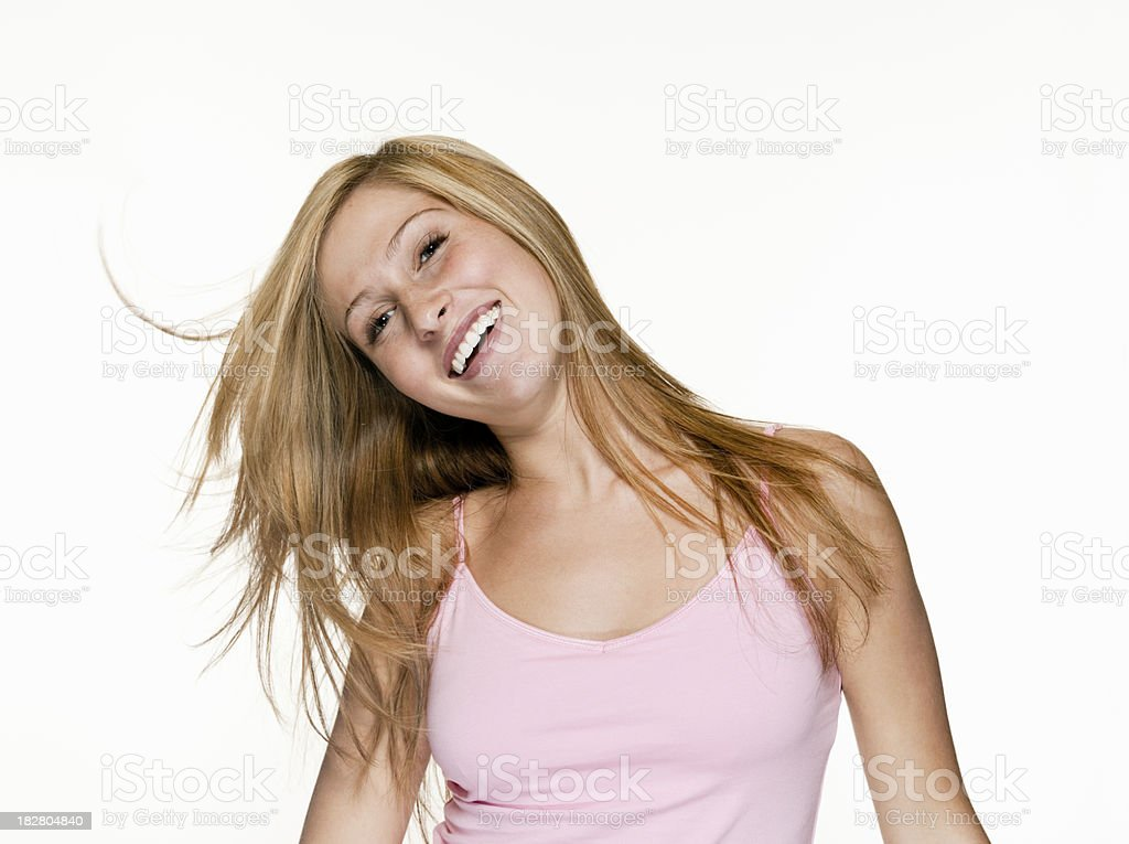 Smiling Teenage Girl Tossing Hair royalty-free stock photo