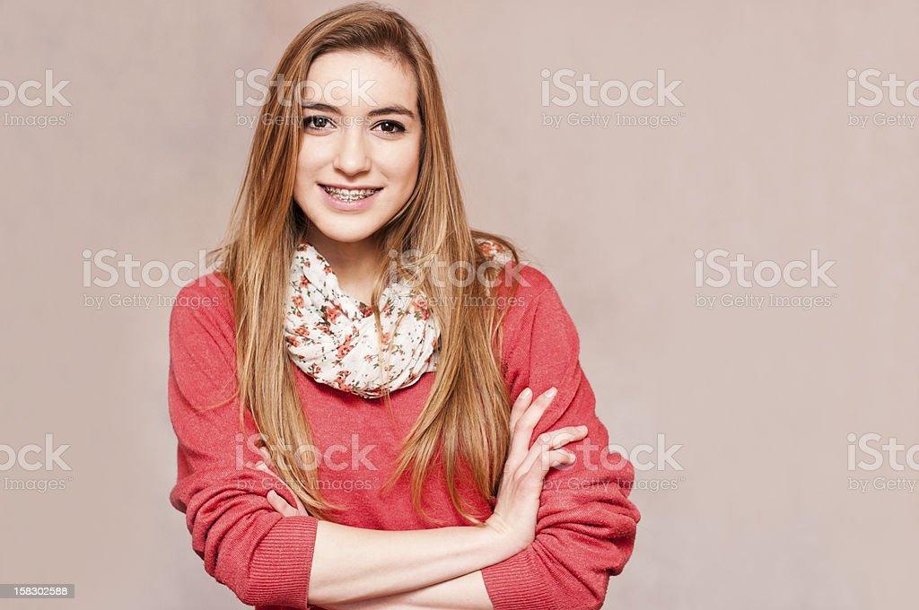 Smiling teenage girl with braces stock photo